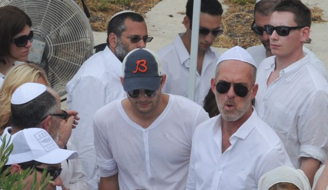 Mystic Man: Movie star Ashton Kutcher attends funeral for Rabbi Philip Berg in Israeli city of Safed.