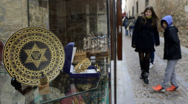 Tourists walk through the old Jewish quarter in the Spanish city of Toledo.