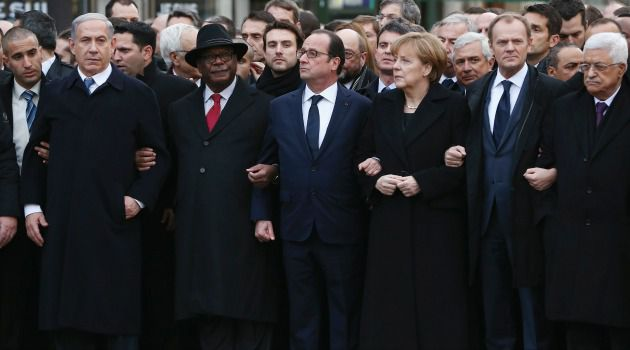 Race to Front? Benjamin Netanyahu links arms with leaders at Paris anti-terror march. Did the Israeli leader's aides shove him into the front row for photos to be beamed worldwide?
