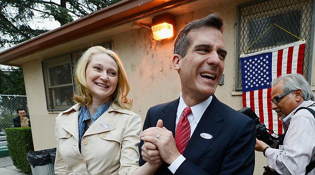 Watershed Vote: Eric Garcetti, shown here voting with his wife, would be the first Jewish mayor of Los Angeles. But ethnic appeals don?t seem likely to play a big role in his run-off election against Wendy Greuel.