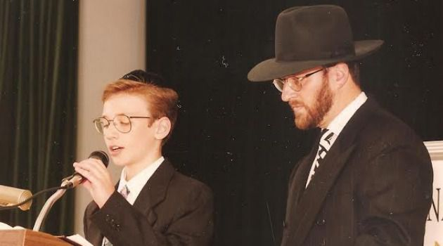 Like Father, Like Son: Eliyahu Fink speaks at his bar mitzvah in 1994 as his father, Aaron Fink, looks on.