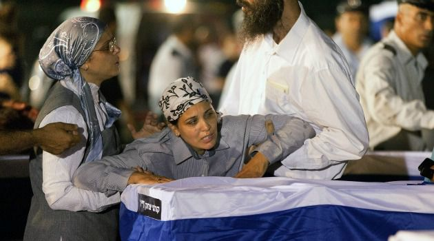 Numbing Grief: Israeli mourners grieve for victims of the terrorist bombing in Bulgaria.