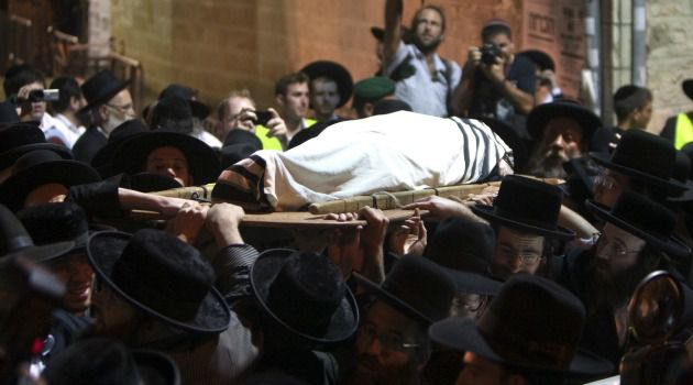Revered Rabbi: Rabbi Yosef Shalom Elyashiv is carried from his home in Jerusalem. The Haredi rabbi may be followed by different leaders competing for prominence.