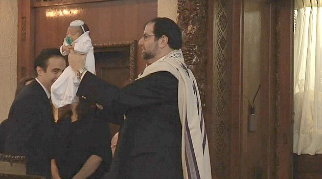 Ancient Ritual: Cantor Philip L. Sherman performs a bris at a Long Island synagogue.