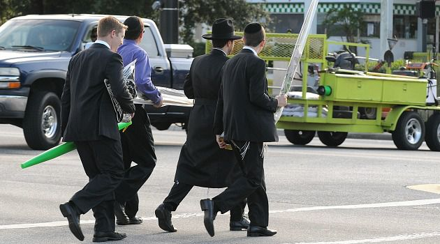 Dangerous Crossing: Orthodox Jews cross the intersection where Esther Ohayon was struck and killed on Yom Kippur. Pedestrians have only a few seconds to cross the wide street if they cannot push the ?walk? button on Shabbat or holidays.