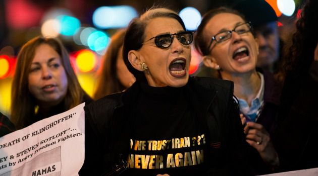 Anger Over Art: Protesters denounce 'The Death of Klinghoffer' at a rally outside the opera's debut at the Metropolitan Opera in New York.