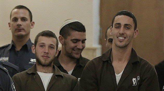Members of Lehava, a Jewish extremist group, joke during their court appearance on charges of torching a school dedicated to Arab-Jewish coexistence.