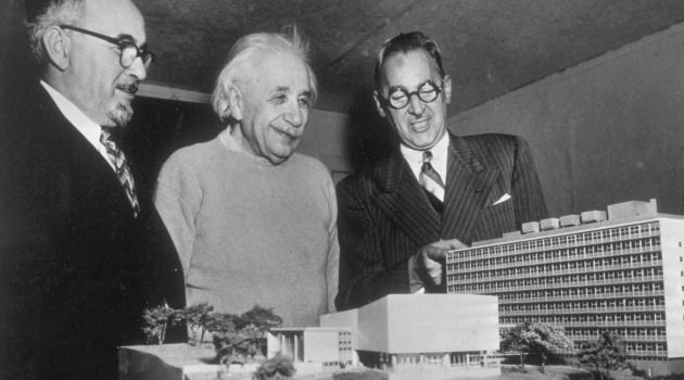 Model Med School: Albert Einstein checks out scale model of Yeshiva University's medical school in the Bronx. He is flanked by Yeshiva University president, Samuel Belkin (left) and New York's attorney general, Nathaniel Goldstein.