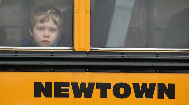 First Day Back: A Newtown student peers out of a school bus. Schools were open for the first time in the Connecticut town since the deadly rampage on Friday.