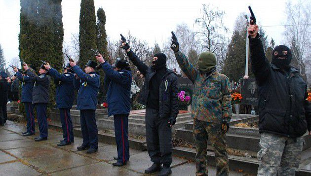 Scary Sight:Far right wing gunmen and Ukrainian policemen at the funeral of Alexander Scherbanyuk.