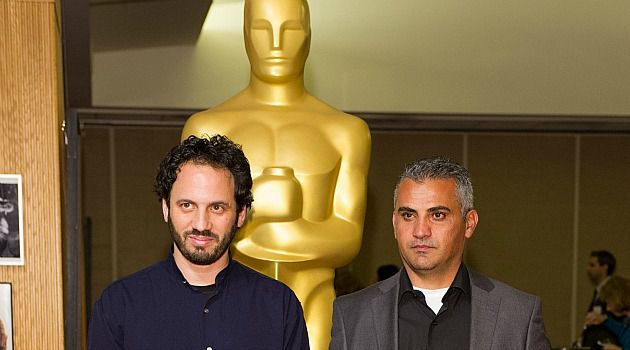 The Envelope, Please: Director Emad Burnat, right, says it would be a historic day for Palestinians if ?5 Broken Cameras,? the film he made with Guy Davidi, wins an Oscar for best documentary.
