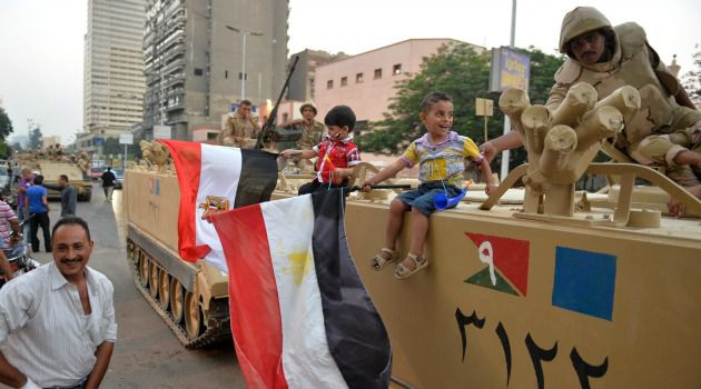 No More Mo: Egyptians cheer army troops after the military ousted President Mohamed Morsi and announced a transition to new elections.