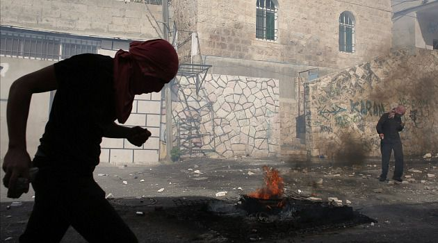 Neighborhood Clashes: Palestinian youths battle Israeli police in the Jerusalem neighborhood of Abu Tor, to which correspondent Naomi Zeveloff just moved.