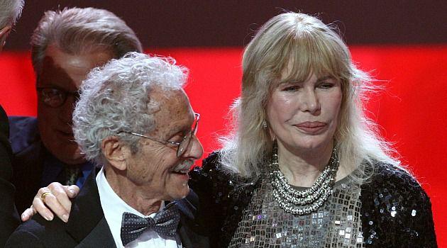 TV Icons: Actor Allan Arbus embraces fellow MAS*H actor Loretta Swit at a TV awards presentation.