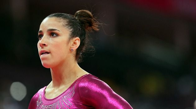 Stunned: Aly Raisman watches as she was placed fourth in the individual women?s Olympic gymnastics competition.