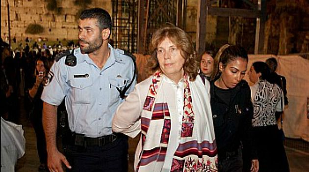 ?Cuff Her: Jerusalem police lead away Anat Hoffman after she was arrested for praying at the Wailing Wall last week.
