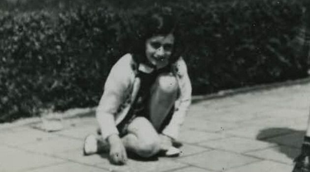 Anne Frank plays marbles on the sidewalk before the Nazi invasion of Holland.