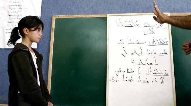 Not-So-Dead Language: A student listens to Israeli Arab teacher Amir Khalul (not seen) during Aramaic class in the Israeli Arab village of Jish.