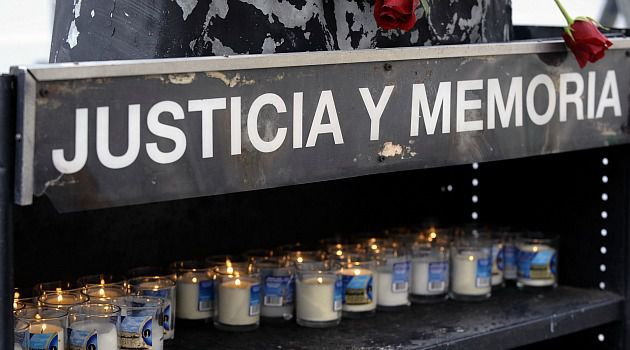 Justice and Memory: Candles burn at a memorial to the 85 victims of the 1994 terror bombing of a Jewish center in Buenos Aires, Argentina.