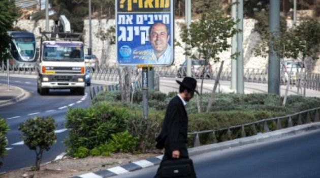Race Card: A poster for council candidate Aryeh King reads: ?Muezzin calling? You need King.?