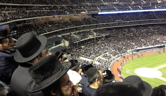 Kosher Message? Ultra-Orthodox rabbis pack Shea Stadium to condemn the internet in June 2012. With Hasidim flocking to WhatsApp, will the free messaging service be their next target?