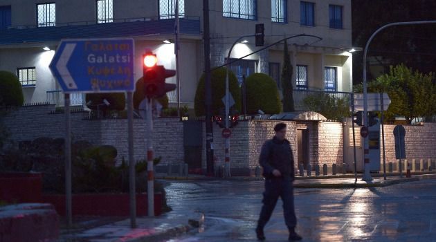 Greek police officer investigates shots fired at Israeli embassy in Athens.
