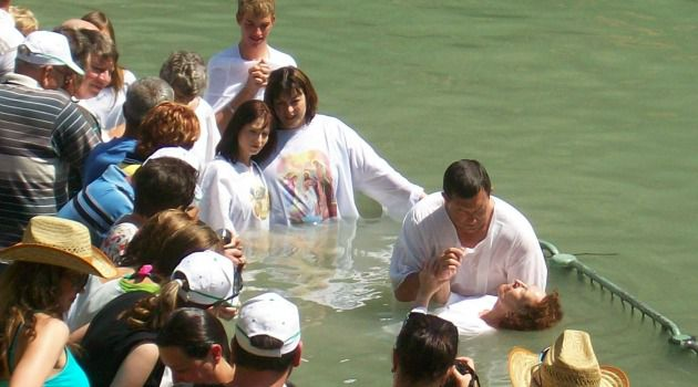 You?ve Been Dunked: Christian pilgrims dip at Yardenit.