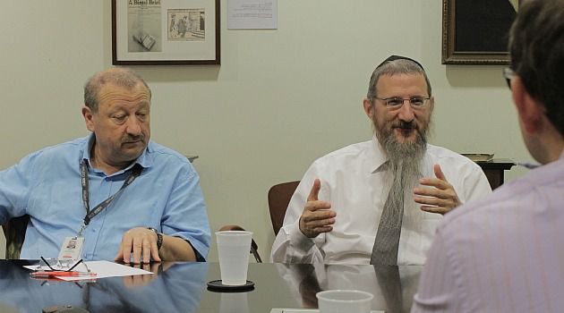 Don?t Say No: Russian Chief Rabbi Berel Lazar, right, speaks to journalists at the Forward?s offices in lower Manhattan.
