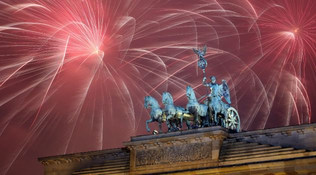 Fireworks erupt above Berlin's Brandenburg Gate on New Year's Eve, just minutes before a Jewish man was beaten for objecting to anti-Semitic songs on the city's subway.