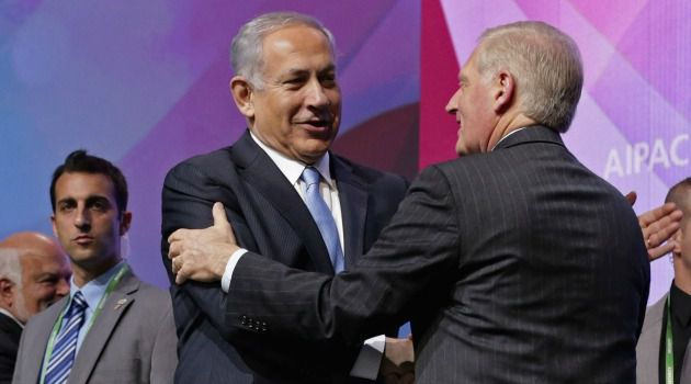 All Smiles: Israeli Prime Minister Benjamin Netanyahu greets AIPAC Executive Director Howard Kohr before addressing the crowd in Washington, D.C.