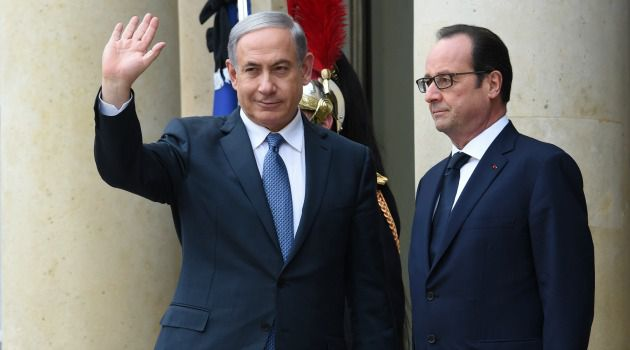 Bienvenue à Paris: French President Francois Hollande welcomes Israeli Prime Minister Benjamin Netanyahu before attending a Unity rally Marche Republicaine in Paris.
