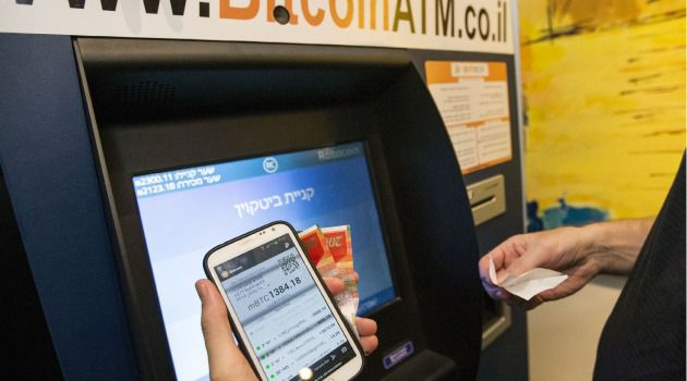 Virtual Cash Machine: Customer obtains bitcoins from an ATM in Tel Aviv.