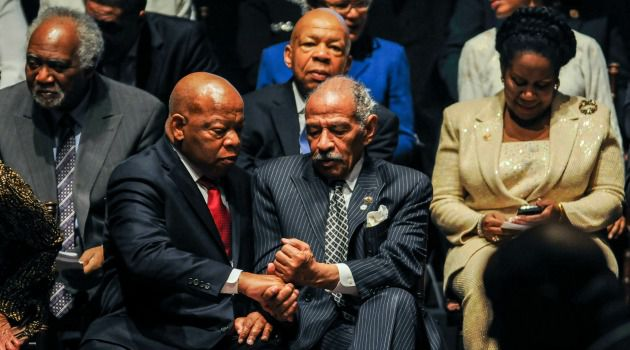 Together as One: John Lewis (D-Ga.) gives fist bump to John Conyers (D-Mi.) at the ceremonial swearing-in of members of the Congressional Black Caucus.