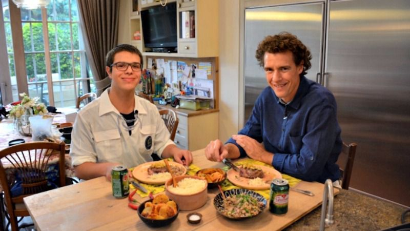 Danny Ashkenazi(left) and Tom Franz preparing to eat filet Osvaldo Aranha in Jerusalem, Nov. 2016.