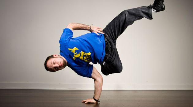 Moves: Michael Prosserman breakdances without touching his head to the floor, to avoid injury.