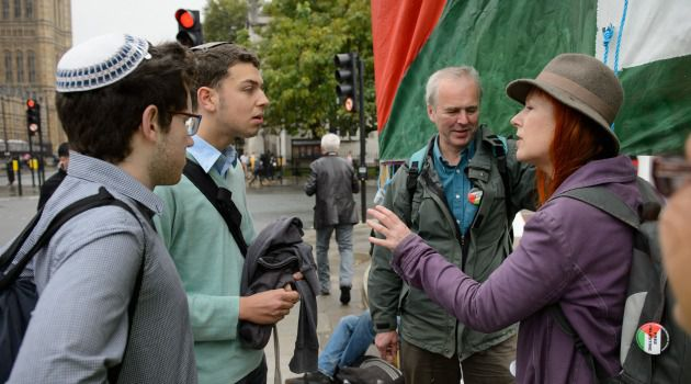 Yes and No: Supporters and opponents of measure to recognize Palestine as state argue outside British parliament.