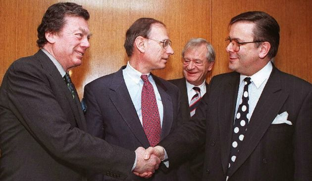 Global Cachet: Edgar Bronfman , left, greets Alfred Defago, right, Swiss consul general in New York, in 1997 before beginning a meeting of the World Jewish Restitution organization