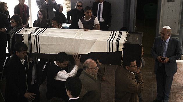 Rare Show of Faith: Scores of Egyptian Jews attended the public funeral of Carmen Weinstein, the longtime leader of the country?s tiny Jewish community. It was a very rare public showing of faith for the dwinding population.
