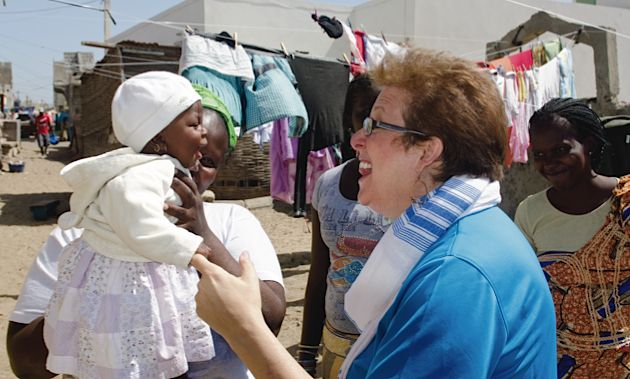 Child Advocate: Caryl Stern, pictured in Senegal, has three sons of her own.