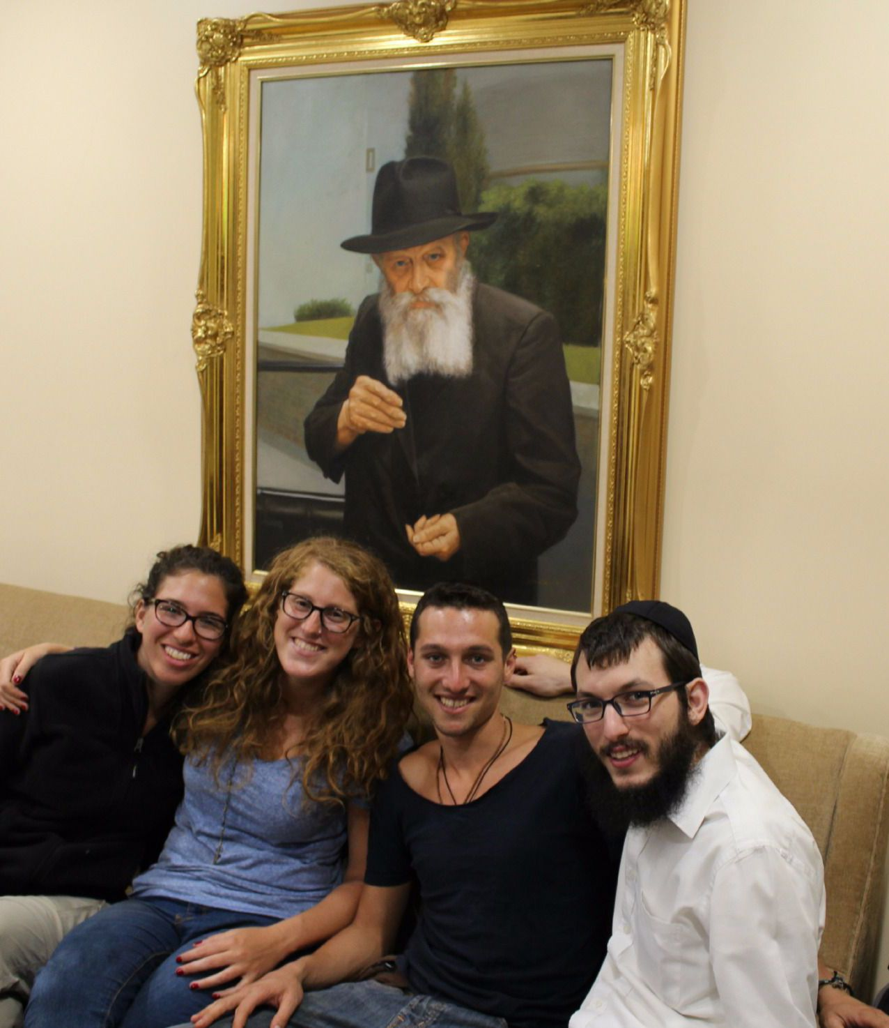 Under the Rebbe: Chabad Rabbi Israel Kozlowsky with Israeli tourists.