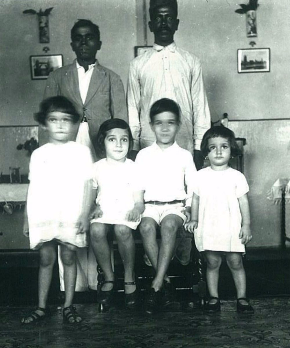 Faded Memory: The author's grandmother (front right) with her siblings and servants in 1930s Bombay.