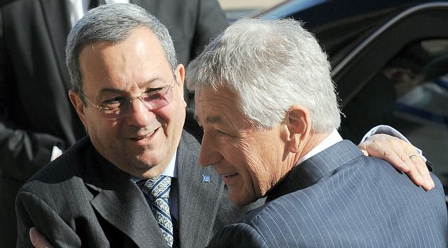 Close Allies: Newly minted Defense Secretary Chuck Hagel embraces his Israeli counterpart, Ehud Barak.