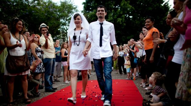 We Do: Israeli bride Yulia Tagil and her groom, Stas Granin, hold an alternative wedding ceremony at a public square in Tel Aviv to protest Orthodox control over marriage. Proposed reforms would allow a more flexible approach.