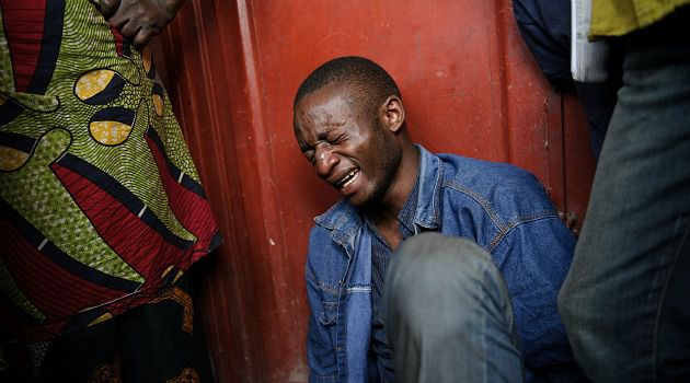 His Tears Are Real: A Congolese man weeps after discovering the body of his father, who was killed the ongoing unrest in the east of that vast African land.