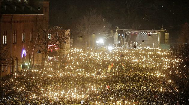 Torches of Hope: Tens of thousands of Danes gather to protest the Copenhagen terror shootings, and mourn the dead.