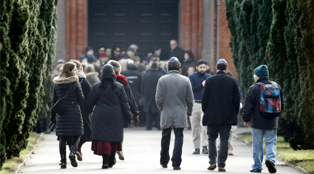 Together as One: Mourners walk to a memorial service for the Jewish guard slain in the Copenhagen terror attacks.