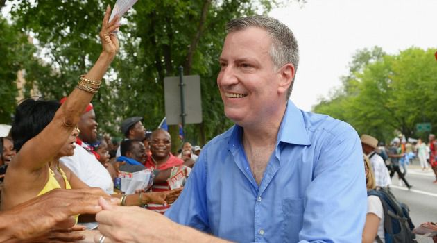 Satmar vs. Satmar: New York mayoral candidate Bill de Blasio, shown here campaigning at the West Indian carnival in Brooklyn, has won the endorsement of a group of Satmar Hasidic Jews. That sets up a battle for the votes of the Hasidic community, as another group has endorsed Bill Thompson.