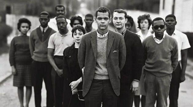 Dorothy Zellner, center, stands behind civil rights leader Julian Bond.