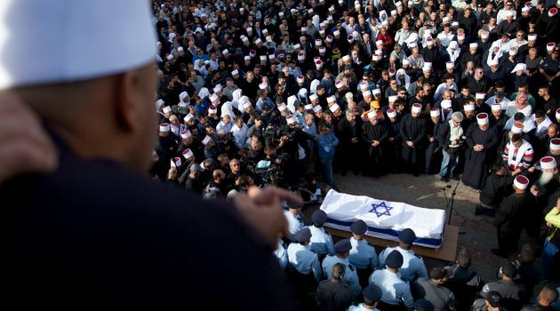 'Our Very Flesh'Druze and Israelis attend funeral of Zidan Saif, a police officer killed in the Jerusalem terror attack.