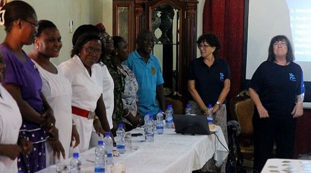 We Know Trauma: IsraAid psychosocial trauma specialists Hela Yaniv, left, and Sheri Oz lead a counseling and training session for service providers in Sierra Leone.